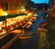 Venice at night by the canal.